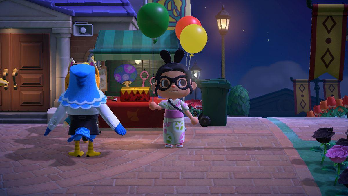 Un personaje de Animal Crossing sostiene un globo verde.