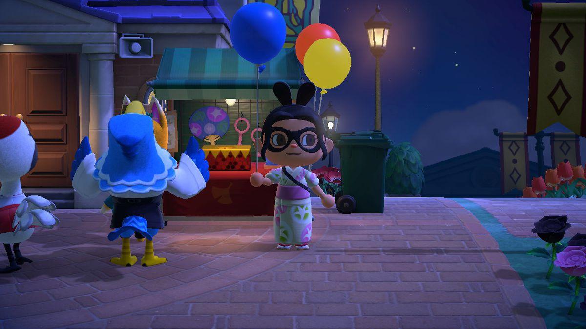 Un personaje de Animal Crossing sostiene un globo azul.