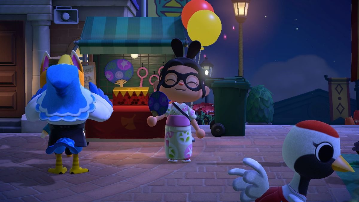 Un personaje de Animal Crossing sostiene felizmente un ventilador