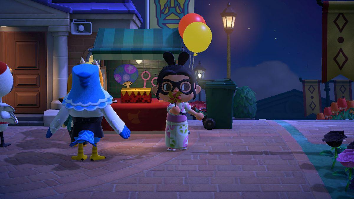 Un personaje de Animal Crossing sopla en un molinillo