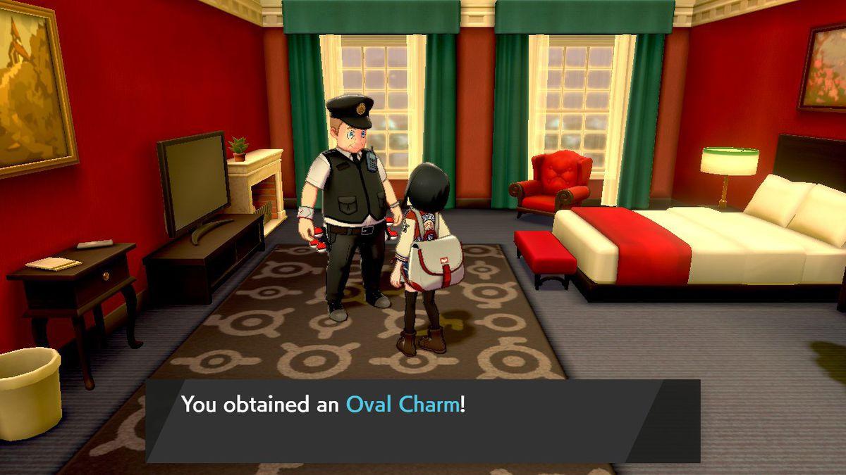 Un oficial de policía NPC, Morimoto, recompensa al jugador con un amuleto ovalado.