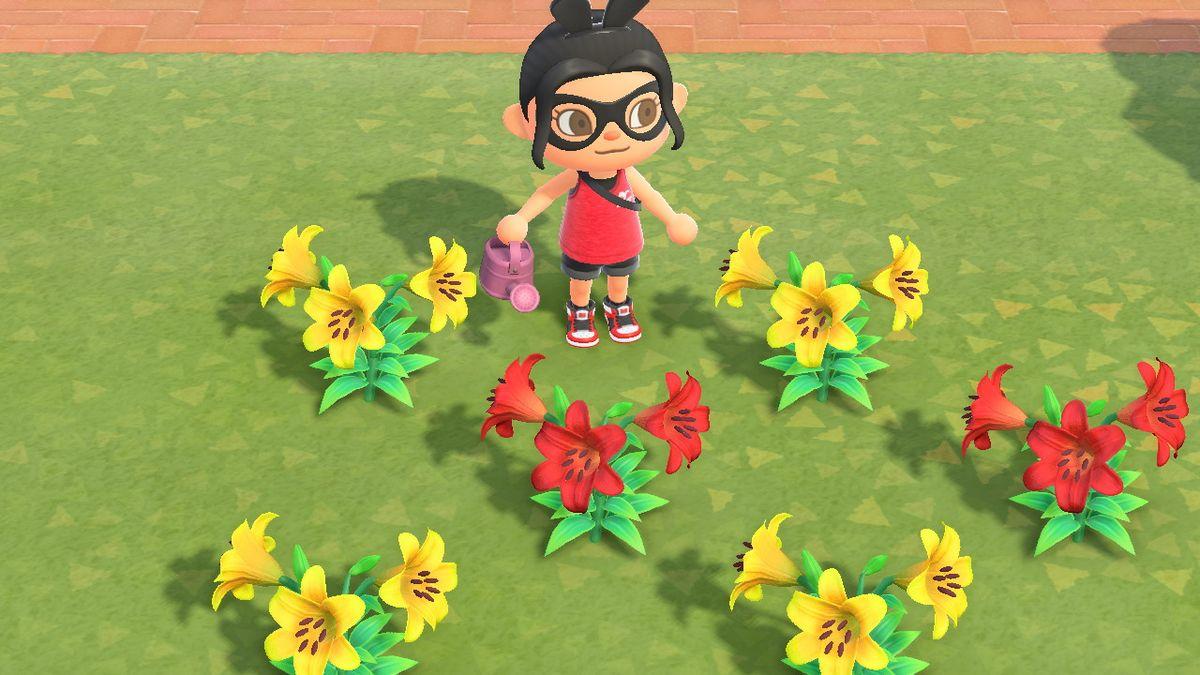 Un personaje de Animal Crossing con una regadera rosa está parado cerca de lirios amarillos y rojos