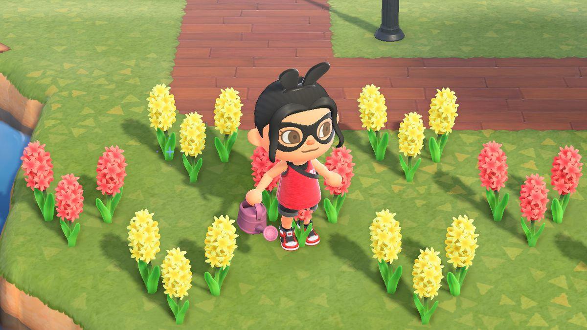 Un personaje de Animal Crossing se encuentra cerca de rosas amarillas y blancas.