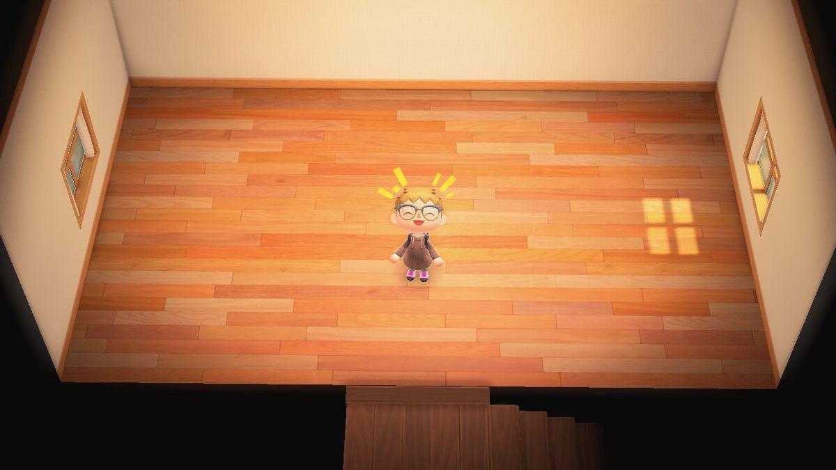 Un personaje de Animal Crossing sonríe en una gran habitación vacía